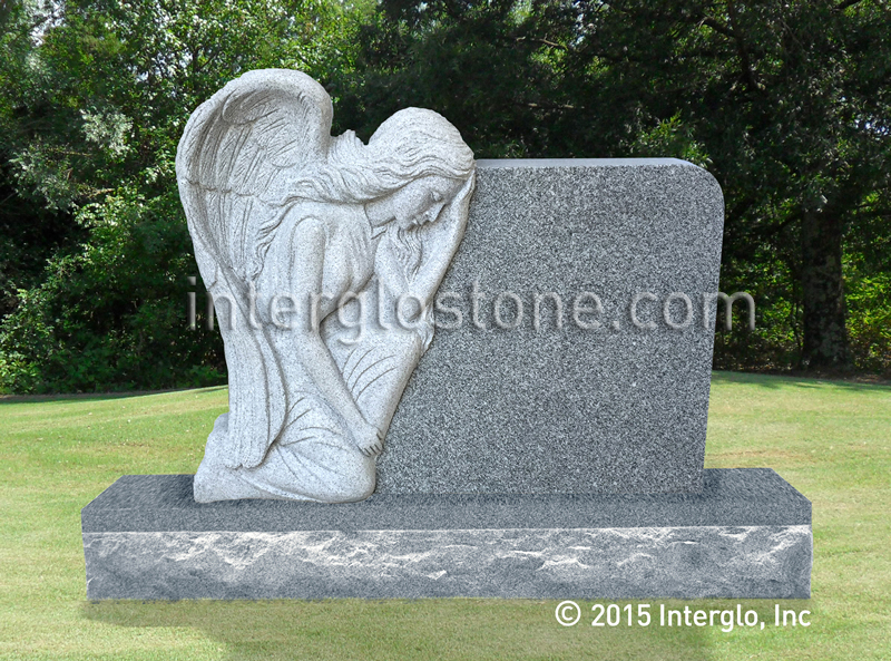 Grieving Angel on Rock Headstone